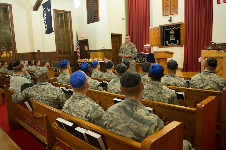 Chaplain Kahan, 502nd Air Base Wing Jewish chaplain, speaks to the congregation Dec. 13, 2015. The 502nd Air Base Wing Chaplain's Office gives Airmen in basic training and technical school the opportunity to attend the traditional ceremony and enjoy traditional Hanukkah refreshments and activities afterward. Hanukkah, which is celebrated this year from sundown Dec. 24 to sundown Jan. 1, is known as the Festival of Lights. (Courtesy Photo)