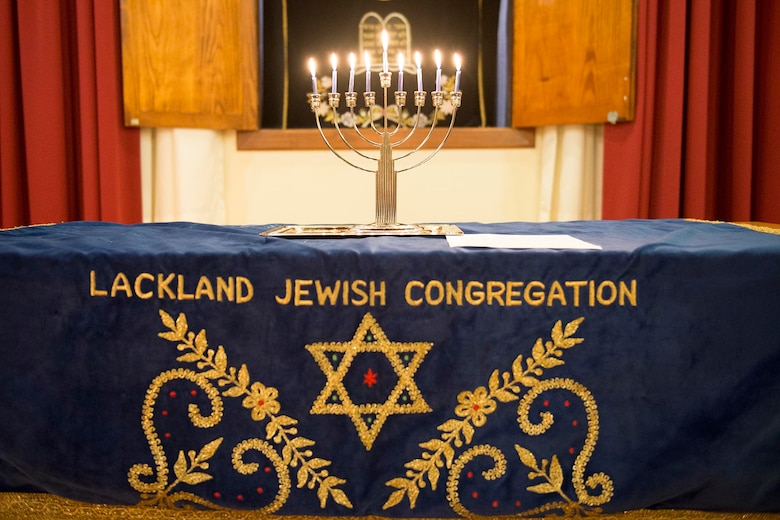 Hanukkah, which is celebrated this year from sundown Dec. 24 to sundown Jan. 1, is known as the Festival of Lights. Following Hanukkah tradition, one candle is lit each night throughout eight days to honor the miracle of the Hanukkah lights. The 502nd Air Base Wing Chaplain's Office gives Airmen in basic training and technical school the opportunity to attend the traditional ceremony and enjoy traditional Hanukkah refreshments and activities afterward. (Courtesy Photo)