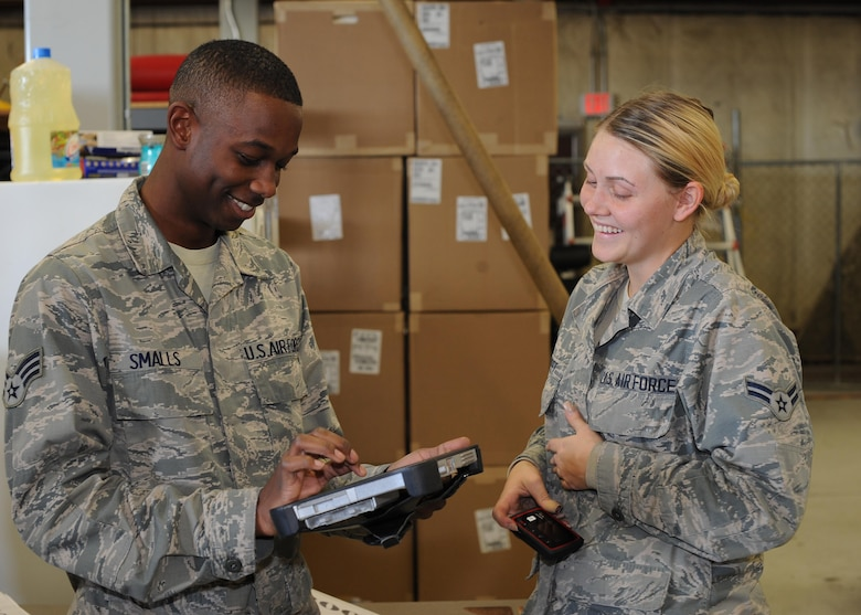 U.S. Air Force Senior Airman Trevien Smalls, 355th Equipment Maintenance Squadron material management, signs for a delivery from Airman 1st Class Katherine Street, 355th Logistics Readiness Squadron vehicle operator, at Davis-Monthan Air Force Base, Ariz., Dec. 14, 2016. The use of new Wi-Fi hot spots are making signing for deliveries smoother and more efficient, saving man-hours in both the 355th LRS and receiving units. (U.S. Air Force photo by Senior Airman Ashley N. Steffen)