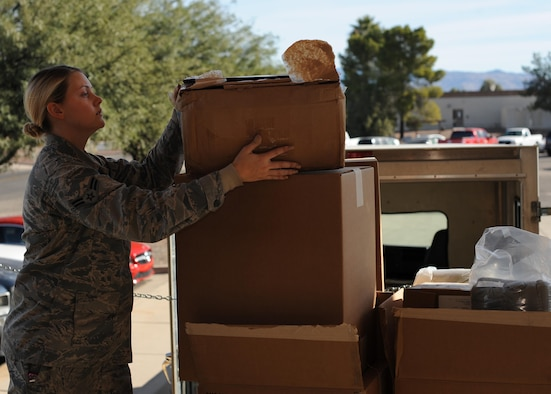 U.S. Air Force Airman 1st Class Katherine Street, 355th Logistics Readiness Squadron vehicle operator, receives packages for delivery at Davis-Monthan Air Force Base, Ariz., Dec. 14, 2016. Once supplies are delivered to the installation, LRS distributes them to individual units across the base allowing supplies to be readily available. (U.S. Air Force photo by Senior Airman Ashley N. Steffen)