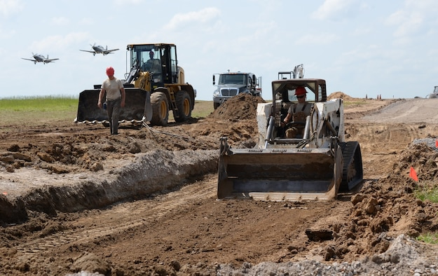 Airmen from the 823rd Rapid Engineer Deployable Heavy Operational Repair Squadron, Engineering, Hurlburt Field, Florida, work on the flightline of Columbus Air Force Base, Mississippi, July 12, 2016. Airmen from the 823rd REDHORSE work on these sorts of projects to meet training requirements and prepare for deployments, which also benefit stateside Air Force bases. (U.S. Air Force photo by Airman 1st Class John Day)