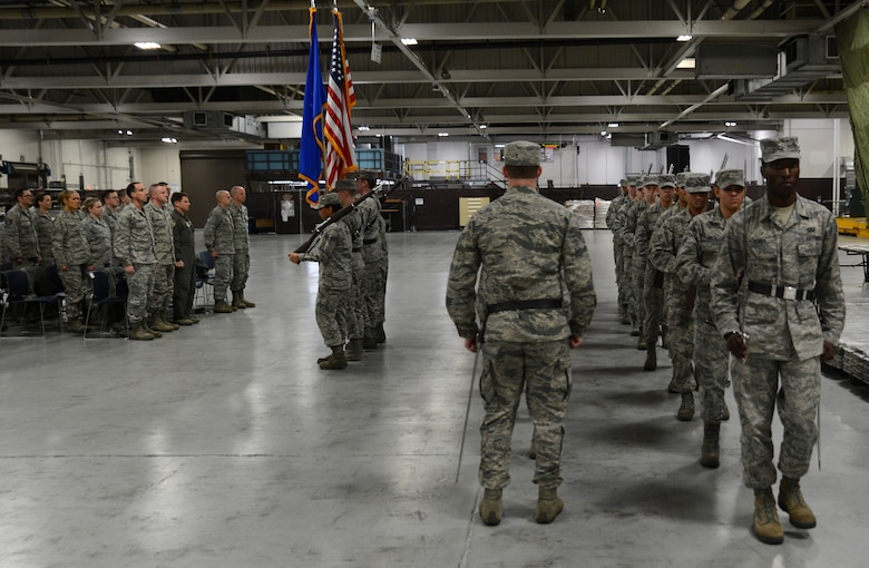 Airmen from the McChord Field Honor Guard perform facing movements during a change or responsibility ceremony Dec. 13, 2016, at Joint Base Lewis-McChord, Wash. The ceremony allowed McChord leadership to honor both incoming and outgoing McChord Field Honor Guard ceremonial guardsmen. (U.S. Air Force photo/Senior Airman Jacob Jimenez)