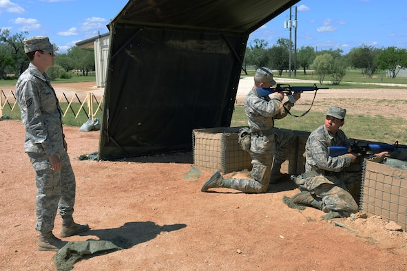 Staff Sgt. Britney Simpson (left), 319th Training Squadron military training instructor, directs trainees on proper escalation of force procedures during a training exercise Sept. 28 at the Joint Base San Antonio-Lackland Medina Annex. (U.S. Air Force photo by Staff Sgt. Marissa Garner)