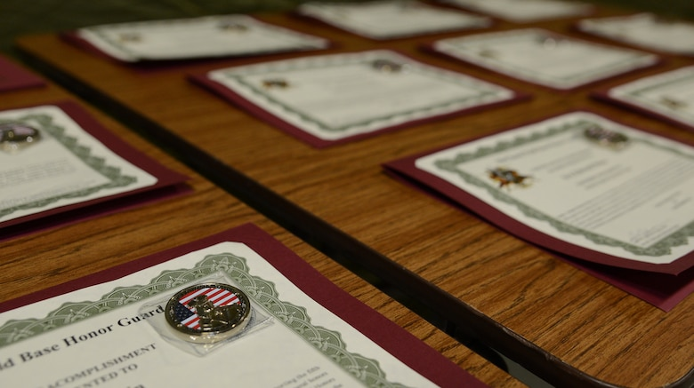 McChord Base Honor Guard graduation certificates are displayed during a change or responsibility ceremony Dec. 13, 2016, at Joint Base Lewis-McChord, Wash. The certificates were given to the graduating flight for completing a two week honor guard training course. (U.S. Air Force photo/Senior Airman Jacob Jimenez)