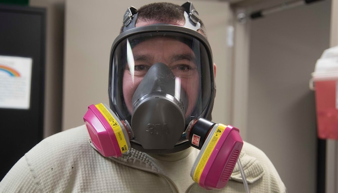 Staff Sgt. Nathan Gilbert, 141st Maintenance Squadron metals technician, participates in a respirator mask fit test Dec. 7, 2016 at Fairchild Air Force Base, Washington. Gilbert completed the respirator fit test as part of requirements for accomplishing his duties as a metals technician. (U.S. Air Force photo/Senior Airman Nick J. Daniello)