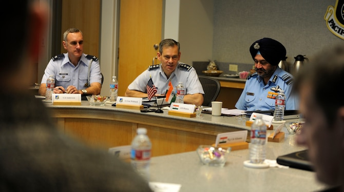 U.S. Air Force Lt. Gen. Ken Wilsbach, commander 11th Air Force, seated with Indian Force Air Marshal Birender Dhanoa, Vice Chief of the Air Staff, Dec. 13, 2016, issues his opening remarks, officially beining the first day of the Executive Steering Group.  Senior military leaders from the Indian Air Force and the U.S. Air Force held an executive steering group meeting to discuss operational concepts and chart the way ahead for future training exchanges and exercises between both militaries. (U.S. Air Force photo by Master Sgt. George Maddon)