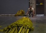 U.S. Airman 1st Class Eric Hornbeck, 379th Expeditionary Operations Support Squadron aircrew flight equipment technician, applies tension to a drag parachute so he can fold it at Al Udeid Air Base, Qatar, Nov. 30, 2016. These drag parachutes are used to help aircraft slow down after landing, and put less strain on the break systems. (U.S. Air Force photo by Senior Airman Miles Wilson)