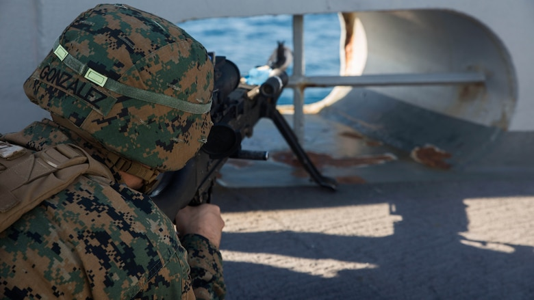 Lance Cpl. Ernesto Gonzalez, an artilleryman from 3rd Battalion, 6th Marine Regiment, with the 24th Marine Expeditionary Unit holds security aboard USS Mesa Verde (LPD 19), during a simulated straight transit to rehearse a defense of the amphibious task force mission during Amphibious Ready Group Marine Expeditionary Unit Exercise Dec. 13, 2016. During the three-week training evolution, Marines will tackle a wide range of operations and scenarios enhancing interoperability and amphibious warfare capabilities with their Navy counterparts. The additional firepower Marines provide improves the Navy-Marine Corps team's ability to defend the naval vessels of the Bataan Amphibious Ready Group.