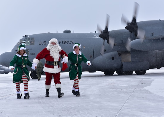 Santa Claus arrives at the Niagara Falls Air Reserve Station December 17, 2016. This is Santa's last visit here aboard a Niagara C-130 Hercules as the 914th Airlift Wing is transitioning to the KC-135 Stratotanker. (U.S. Air Force photo by Staff Sgt. Richard Mekkri)