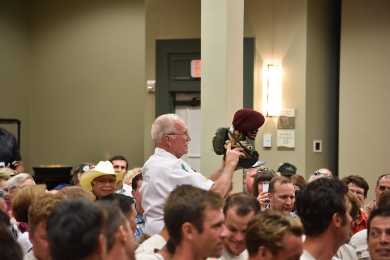 "Charlie ""Chuck"" Morrow, president of the Pararescue Association and former pararecueman, displays the pararesuce mascot, Charlie, at the 2016 Pararescue Reunion in Melbourne, Florida, Sept. 23, 2016. Morrow is the recipient of three Sliver Stars and five Distinguished Flying Crosses for his actions and service during the Vietnam War. (U.S. Air Force photo/Staff Sgt. Dana White)"