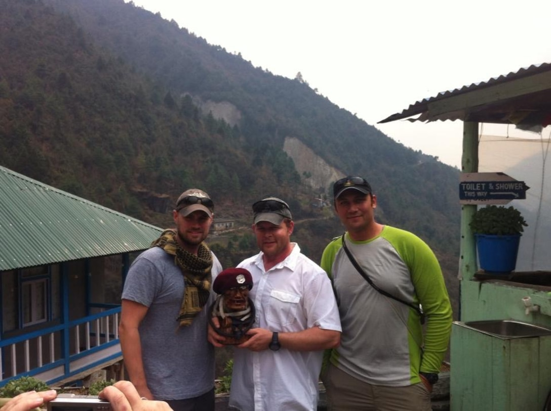 """Then-Senior Master Sgt. Robert Disney, a Wounded Warrior and PJ, holds """"Charlie"""" the PJ during a journey to the Mt. Everest base camp in the Himalayas in 2013. On the trip, Disney met the Dalai Lama, who presented him with a medallion that Charlie now wears. (Courtesy photo)"""