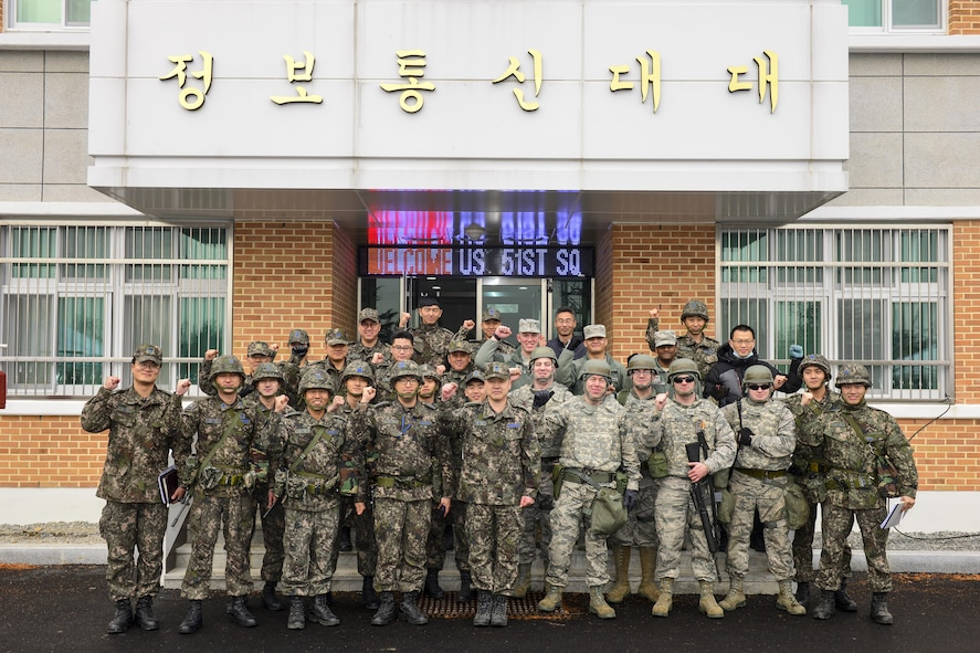 Members of the 51st Communications Squadron pose with their Republic of Korea air force counterparts after the conclusion of a joint communications exercise at Gwanju Air Base, ROK, Dec. 13, 2016. The exercise allowed the U.S. and ROK Airmen to share their expertise and operating procedures, furthering their ability to work together in the field. (U.S. Air Force photo by Senior Airman Victor J. Caputo)
