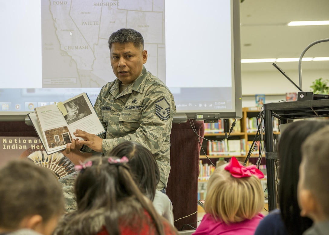 Master Sgt. Edward M. Silversmith, 374th Maintenance Squadron flight chief, reads to children at Mendel Elementary School during a National American Indian Heritage Month event on Nov. 30, 2016, at Yokota Air Base, Japan. Yokota's NAIHM committee held more than 30 reading sessions at Yokota elementary schools. (U.S. Air Force photo by Airman 1st Class Donald Hudson)