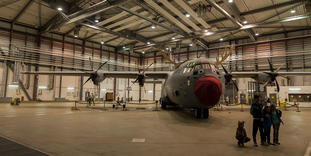 A C-130J Super Hercules sits in a hangar at Ramstein Air Base, Germany, Dec. 16, 2016. Santa opened a workshop at the Dual-Bay Complex here and invited families across the community to participate in holiday festivities. (U.S. Air Force photo by Airman 1st Class Lane T. Plummer)