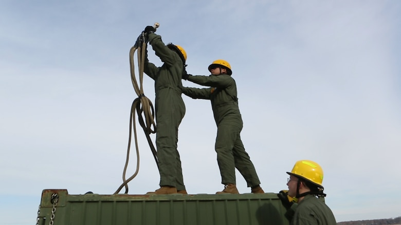 Embarkation Specialists Lance Cpls. Sandre E. Flournoy and Jason B. Embile, both with Logistics Platoon, Chemical Biological Incident Response Force, CBIRF, rehearse proper hooking procedures prior to a sling load operation as part of Initial Reaction Force B certification exercise, CERTEX, aboard Naval Support Facility Indian Head Annex Stump Neck, Md., Dec. 13, 2016. This CERTEX evaluated all sections composing the IRF including identification and detection, technical rescue, decontamination, search and rescue/casualty extraction, medical, explosive ordnance disposal, as well as command and control.  (Official U.S. Marine Corps photo by Staff Sgt. Santiago G. Colon Jr./RELEASED)