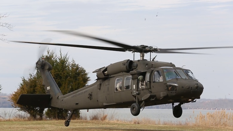 An UH-60 Blackhawk helicopter assigned to 12th Aviation Battalion, U.S. Army, lands prior to a sling load operation as part of Initial Reaction Force B certification exercise, CERTEX, aboard Naval Support Facility Indian Head Annex Stump Neck, Md., Dec. 13, 2016. This CERTEX evaluated all sections composing the IRF including identification and detection, technical rescue, decontamination, search and rescue/casualty extraction, medical, explosive ordnance disposal, as well as command and control.  (Official U.S. Marine Corps photo by Staff Sgt. Santiago G. Colon Jr./RELEASED)