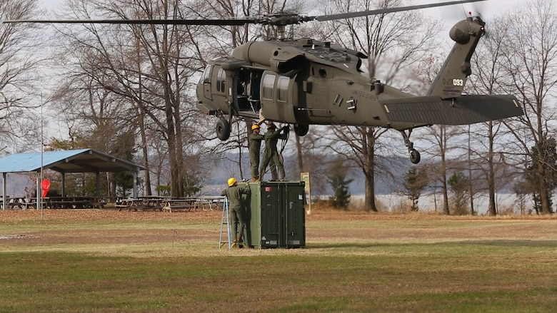 Embarkation specialist Marines with Chemical Biological Incident Response Force, CBIRF, attach a container of supplies to an UH-60 Blackhawk helicopter during a sling load operation as part of Initial Reaction Force B certification exercise, CERTEX, aboard Naval Support Facility Indian Head Annex Stump Neck, Md., Dec. 13, 2016. This CERTEX evaluated all sections composing the IRF including identification and detection, technical rescue, decontamination, search and rescue/casualty extraction, medical, explosive ordnance disposal, as well as command and control.  (Official U.S. Marine Corps photo by Staff Sgt. Santiago G. Colon Jr./RELEASED)