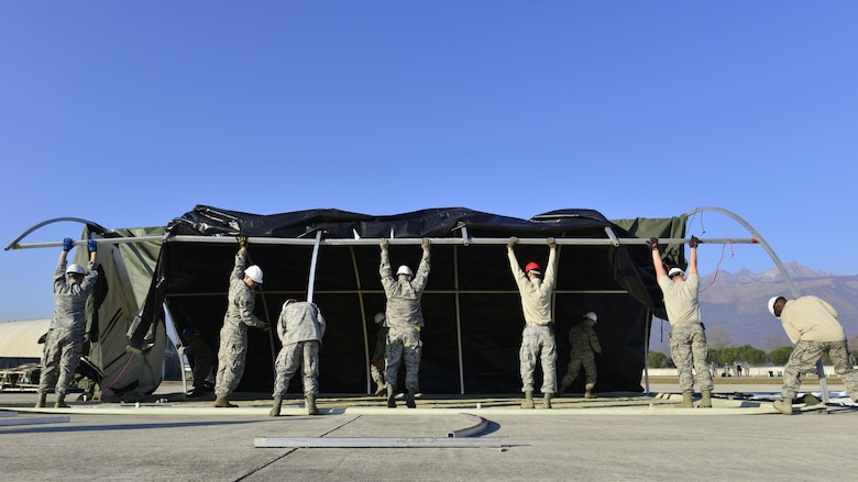 Airmen from the 31st Civil Engineer Squadron construct a tent during an exercise at Aviano Air Base, Italy on Dec. 15, 2016. The exercise was designed to test Team Aviano's capabilities. (U.S. Air Force photo by Senior Airman Cary Smith)