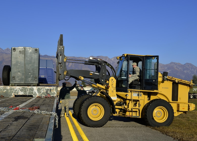 Staff Sgt. Lee Thorpe, 31st Civil Engineer Squadron heavy equipment operator, operates a forklift during an exercise at Aviano Air Base, Italy on Dec. 15, 2016. The exercise was designed to test Team Aviano's capabilities. (U.S. Air Force photo by Senior Airman Cary Smith)