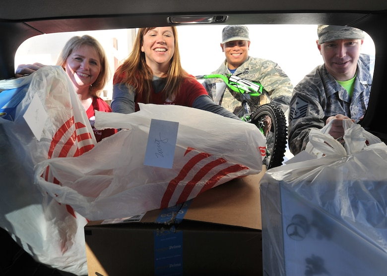 The Tyndall Spouses Club and First Sergeants Group load donated children's gifts during Operation Angel Tree at the base Thrift Shop on Tyndall Air Force Base, Fla., Dec. 16, 2016. Operation Angel Tree provided gifts to 225 children from 128 Tyndall families. (U.S. Air Force photo by Senior Airman Ty-Rico Lea/Released)