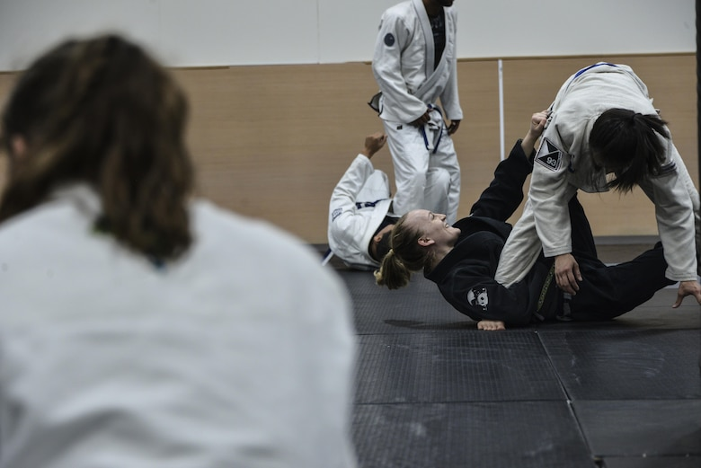Senior Airman Tori, resource advisor, 94th Intelligence Squadron, practices offensive sweeps during her Brazilian Jiu-Jitsu training Dec.14, 2016 in Elkridge, Maryland. As a light feather weight BJJ competitor, Tori has won several events across the U.S. in her division, most recently International Brazilian Jiu-jitsu Federation New York Pro. She will be competing in 2017 in the International Brazilian Jiu-jitsu Federation Atlanta Pro and possibly 2017's World Jiu-Jitsu IBJJF Championship. (U.S. Air Force photo/Staff Sgt. Alexandre Montes)