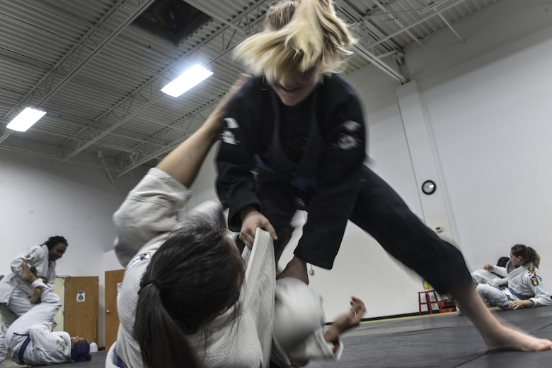 Senior Airman Tori, resource advisor, 94th Intelligence Squadron, practices offensive guard passing during her Brazilian Jiu-Jitsu training Dec.14, 2016 in Elkridge, Maryland. As a light feather weight BJJ competitor, Tori has won several events across the U.S. in her division, most recently International Brazilian Jiu-jitsu Federation New York Pro. She will be competing in 2017 in the International Brazilian Jiu-jitsu Federation Atlanta Pro and possibly 2017's World Jiu-Jitsu IBJJF Championship. (U.S. Air Force photo/Staff Sgt. Alexandre Montes)