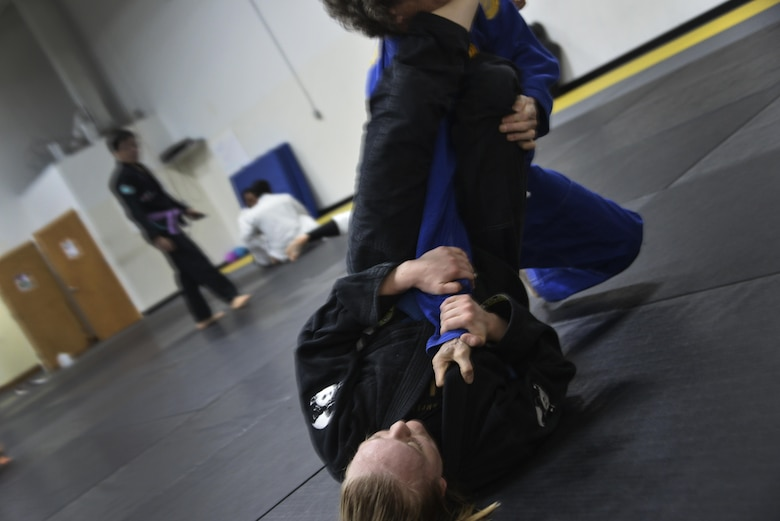 Senior Airman Tori, resource advisor, 94th Intelligence Squadron, sinks in an arm bar submission during her Brazilian Jiu-Jitsu training Dec. 14 in Elkridge, Maryland. As a light feather weight BJJ competitor, Tori has won several events across the U.S. in her division, most recently International Brazilian Jiu-jitsu Federation New York Pro. She will be competing in 2017 in the International Brazilian Jiu-jitsu Federation Atlanta Pro and possibly 2017's World Jiu-Jitsu IBJJF Championship. (U.S. Air Force photo/Staff Sgt. Alexandre Montes)