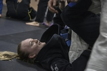 Senior Airman Tori, resource advisor, 94th Intelligence Squadron, practices offensive sweeps during her Brazilian Jiu Jitsu training Dec. 14 in Elkridge, Maryland. As a light feather weight BJJ competitor, Tori has won several events across the U.S. in her division, most recently International Brazilian Jiu-jitsu Federation New York Pro. She will be competing in 2017 in the International Brazilian Jiu-jitsu Federation Atlanta Pro and possibly 2017's World Jiu Jitsu IBJJF Championship. (U.S. Air Force photo/Staff Sgt. Alexandre Montes)