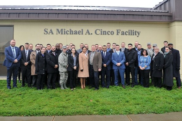 Air Force Office of Special Investigations members gather outside the newly dedicated SA Michael A. Cinco Facility, at Beale Air Force Base, Calif.,  following its dedication Dec. 14, 2016, to the memory of the Fallen Agent killed in action Dec. 21, 2015 near Bagram Air Field, Afghanistan. (U. S. Air Force photo/Airman Tristan D. Viglianco, 9 RW/PA)