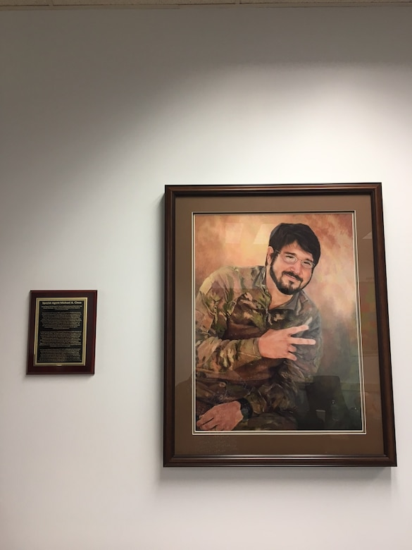Inside the newly dedication Special Agent Michael A. Cinco Facility at Beale Air Force Base, Calif., is a framed portrait and biography of the Fallen Agent killed in action Dec. 21, 2015, near Bagram Air Field, Afghanistan. (U. S. Air Force photo/Airman Tristan D. Viglianco 9 RW/PA)