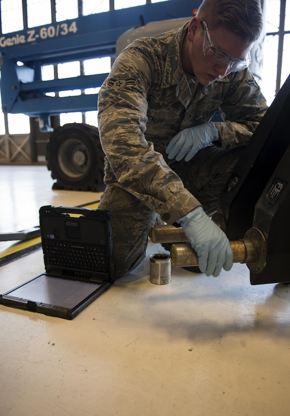 Airman 1st Class Tage Sickler 92nd Maintenance Squadron hydraulics systems apprentice, prepares to attach the ruddervators to the refueling boom Dec. 16, 2016, at Fairchild Air Force Base, Wash. There are two slots on either side of the torque tube where bolts can go through, keeping the ruddervator from rotating within the bell crank, allowing the ruddervator to be controlled. (U.S. Air Force photo/ Airman 1st Class Sean Campbell)