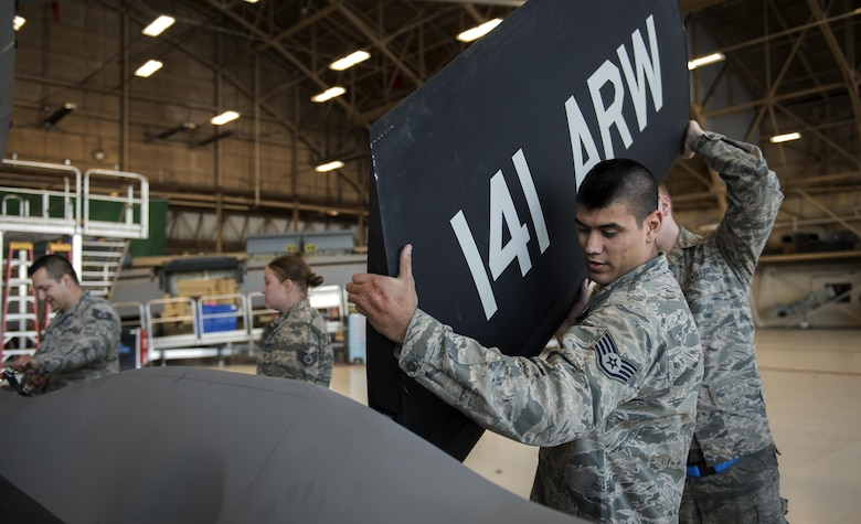 Staff Sgt. Anthony Landin, 92nd Maintenance Squadron hydraulics system craftsman, and Airman 1st Class Tage Sickler 92nd MXS hydraulics systems apprentice, install a ruddervator Dec. 16, 2016, at Fairchild Air Force Base, Wash. If any of the parts located in the ruddervator control system are installed improperly, there is the possibility of damaging the entire boom. (U.S. Air Force photo/ Airman 1st Class Sean Campbell)