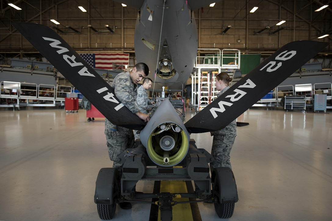 Airmen from the 92nd Maintenance Squadron hydraulics shop prepare a refueling boom to be attached to a KC-135 Stratotanker Dec. 16, 2016, at Fairchild Air Force Base, Wash. This spring, Airmen from the 92nd Maintenance Squadron hydraulics shop were called to fix a KC-135 with an improperly installed boom ruddervator torque tube, which secures the ruddervators to the tanker's refueling boom. (U.S. Air Force photo/ Airman 1st Class Sean Campbell)