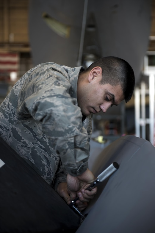 Staff Sgt. Anthony Landin, 92nd Maintenance Squadron hydraulics system craftsman, secures a ruddervator to the refueling boom Dec. 16, 2016, at Fairchild Air Force Base, Wash. A bell crank is a clamp style crank with splines that rotates the torque tube which in turn rotates the ruddervator. (U.S. Air Force photo/ Airman 1st Class Sean Campbell)