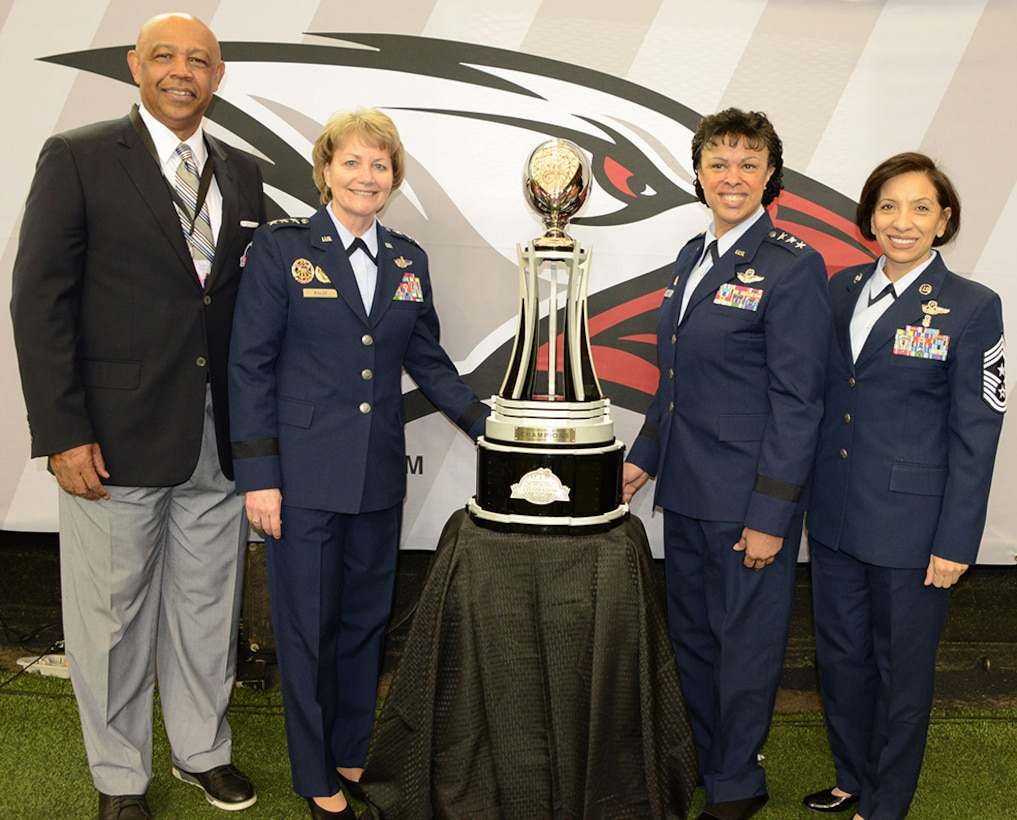 (Left to right) John T. Grant, Air Force Reserve Celebration Bowl executive director; Lt. Gen. Maryanne Miller, chief of the Air Force Reserve and commander of Air Force Reserve Command; Lt. Gen. Stayce D. Harris, assistant vice chief of staff and director, Air Staff, Headquarters U.S. Air Force, Washington D.C.; and Chief Master Sgt. Ericka Kelly, Air Force Reserve Command command chief, pose with the Air Force Reserve Celebration Bowl trophy, which was presented to the Grambling State University Tigers, who defeated the North Carolina Central University Eagles by a score of 10-9. (U.S. Air Force photo/Master Sgt. Chance Babin)
