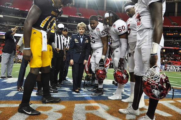 Lt. Gen. Maryanne Miller, chief of the Air Force Reserve and commander of Air Force Reserve Command, conducts the coin toss prior to the Air Force Reserve Celebration Bowl football game between the Grambling State University Tigers and the North Carolina Central University Eagles.  (U.S. Air Force photo/Master Sgt. James Branch)