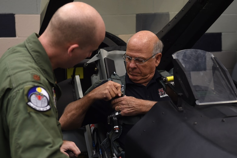 U.S. Rep. Steve Pearce, New Mexico 2nd district, receives training in an F-16 Fighting Falcon simulator, from Maj. Ryan Chute, 54th Operation Support Squadron deputy commander, before Pearce's orientation flight, Dec. 16, 2016, Holloman Air Force Base, N.M. Pearce was offered an orientation flight on the F-16, to better understand the capabilities and mission of the F-16. (U.S. Air Force photo by Tech. Sgt. Amanda N. Junk)