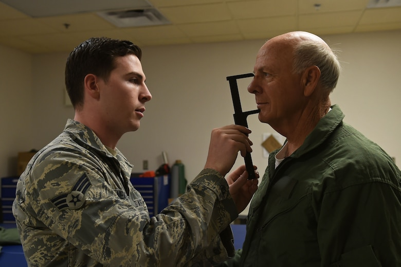 Senior Airman Nicholas Nealeigh, 54th Operation Support Squadron aircrew flight equipment, measures U.S. Rep. Steve Pearce, New Mexico 2nd district, for his face mask prior to his F-16 Orientation flight, Dec. 16, 2016, Holloman Air Force Base, N.M. Pearce was offered an orientation flight on the F-16 Fighting Falcon, to better understand the capabilities and mission of the F-16. (U.S. Air Force photo by Tech. Sgt. Amanda N. Junk)
