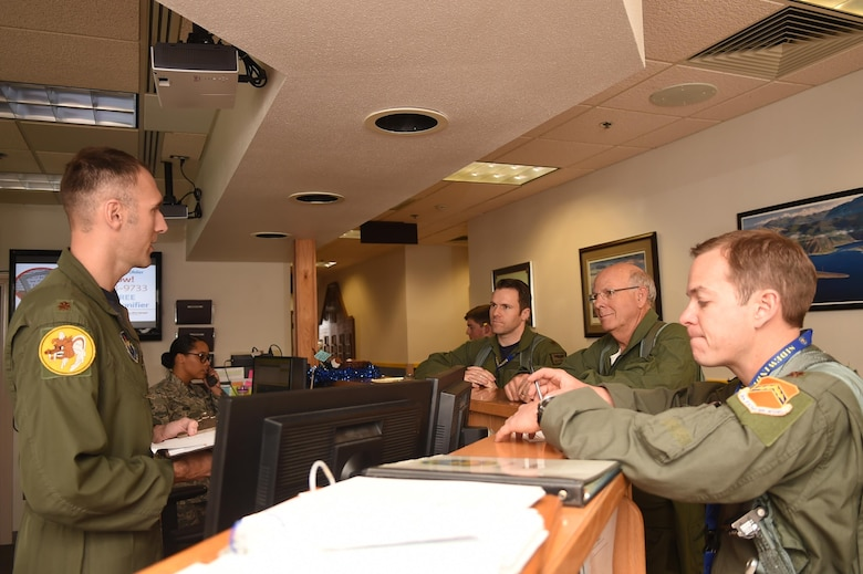 Maj. Brent Ellis (left), 311th Fighter Squadron fighter pilot, briefs U.S. Rep. Steve Pearce (middle right), New Mexico 2nd district, and Maj.'s Matthew Marshall and David Feth, 54th Fighter Squadron fighter pilots, prior to stepping to the aircraft, Dec. 16, 2016, Holloman Air Force Base, N.M. Pearce was offered an orientation flight on the F-16 Fighting Falcon, to better understand the capabilities and mission of the F-16. (U.S. Air Force photo by Tech. Sgt. Amanda N. Junk)