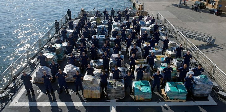 Members of the Coast Guard Cutter Hamilton crew stand next to approximately 26.5 tons of cocaine Dec. 15, 2016 aboard the cutter at Port Everglades Cruiseport in Fort Lauderdale, Florida. The crew of the Coast Guard Hamilton offloaded the cocaine in Port Everglades worth an estimated $715 million wholesale seized in international waters off the Eastern Pacific Ocean since Oct. 1, 2016. Coast Guard photo by Eric D. Woodall