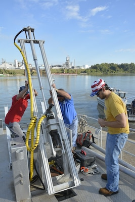 Researchers from ERDC's Coastal and Hydraulics Laboratory set up the drilling rig on the new coring barge. The shallow-draft vessel can reach areas inaccessible to land-based and larger drill rigs, and provides a new capability for U.S. Army Corps of Engineers researchers.