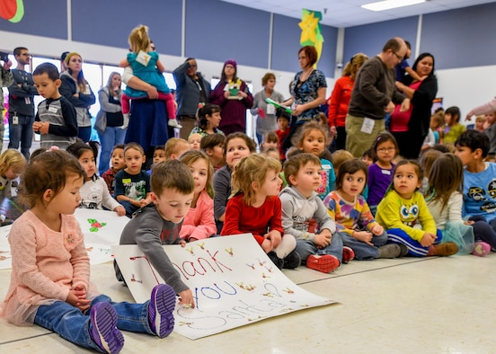 Children anxiously await the arrival of Santa Clause inside the Youth & Family Services center in Rapid City, S.D., Dec. 14, 2016. Angel Tree volunteers from the 28th Operations Group and the U.S. Postal Service provided more than 250 gifts for children enrolled in Y&FS. (U.S. Air Force photo by Airman 1st Class Randahl J. Jenson)