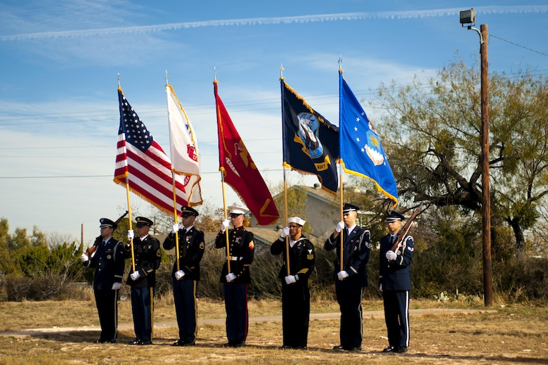 Goodfellow Air Force Base color guard stands ready for the playing of the National Anthem for Wreaths Across America at Belvedere Cemetery, San Angelo, Texas, Dec. 17, 2016. Every December, Wreaths Across America begins in the Arlington Cemetery and travels across the nation, laying wreaths at veteran cemeteries. (U.S. Air Force photo by Senior Airman Scott Jackson/released)