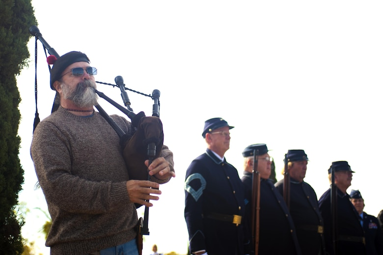 Chris Morgan, Veteran's Day volunteer, plays Amazing Grace on bagpipes after a wreath demonstration for Wreaths Across America at Belvedere Cemetery, San Angelo, Texas, Dec. 17, 2016.  The tradition of the wreath laying ceremony began at Arlington National Cemetery in 1992 and has grown to more than 600 locations across the nation. (U.S. Air Force photo by Senior Airman Scott Jackson/released)
