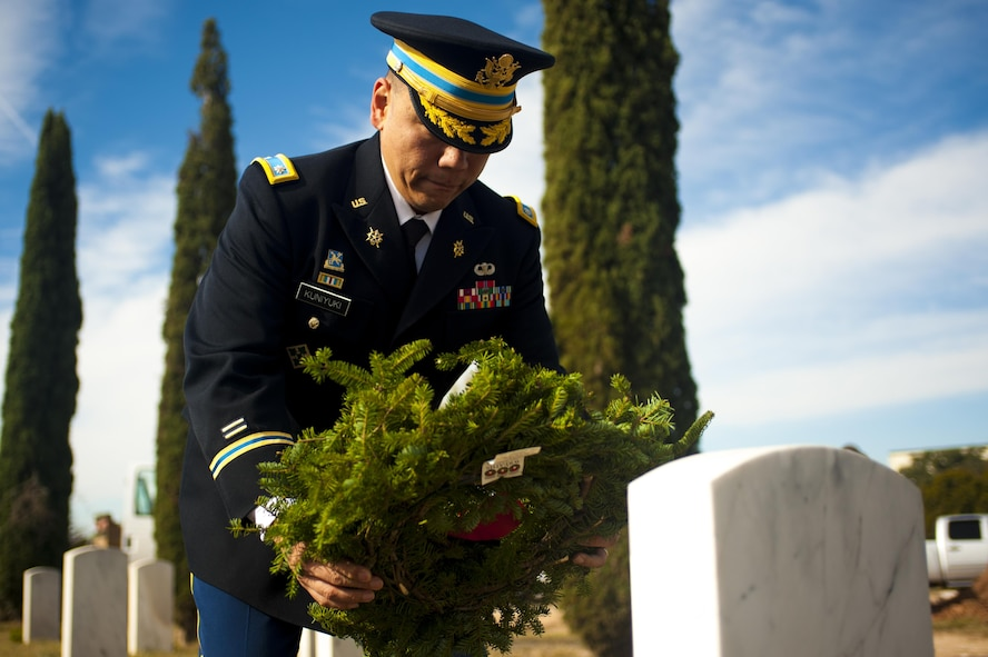 U.S. Army Lt. Col. Yukio Kuniyuki, 344th Military Intelligence Battalion commander, lays a wreath upon a veteran's grave during a Wreaths Across America ceremony at Belvedere Cemetery, San Angelo, Texas, Dec. 17, 2016. Wreaths Across America's mission is remember, honor, teach; remember the fallen, honor those who serve and teach our children the value of freedom. (U.S. Air Force photo by Senior Airman Scott Jackson/released)