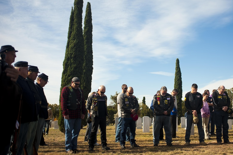 Forth Concho volunteers, Combat Vets Association members and San Angelo members bow their heads during the invocation for Wreaths Across America at Belvedere Cemetery, San Angelo, Texas, Dec. 17, 2016. The ceremony was to honor and give thanks to all deceased veterans. (U.S. Air Force photo by Senior Airman Scott Jackson/released)