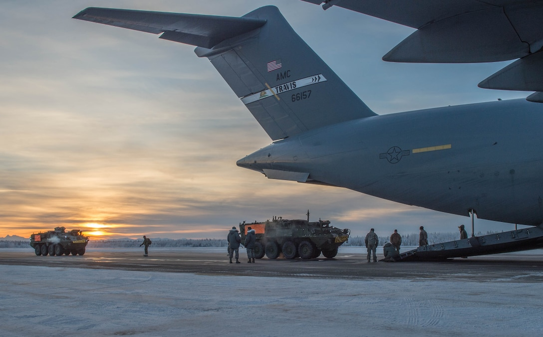 Stryker armored vehicles from the 1st Battalion, 24th Infantry Regiment, 1st Stryker Brigade Combat Team, 25th Infantry Division, is loaded onto a C-17 Globemaster III aircraft, Dec. 13, 2016, at Eielson Air Force Base, Alaska. A contingency response team was sent to Eielson AFB to support the Army's Rapid Alaska Airlift Week exercise. (U.S. Air Force photo by Staff Sgt. Robert Hicks)