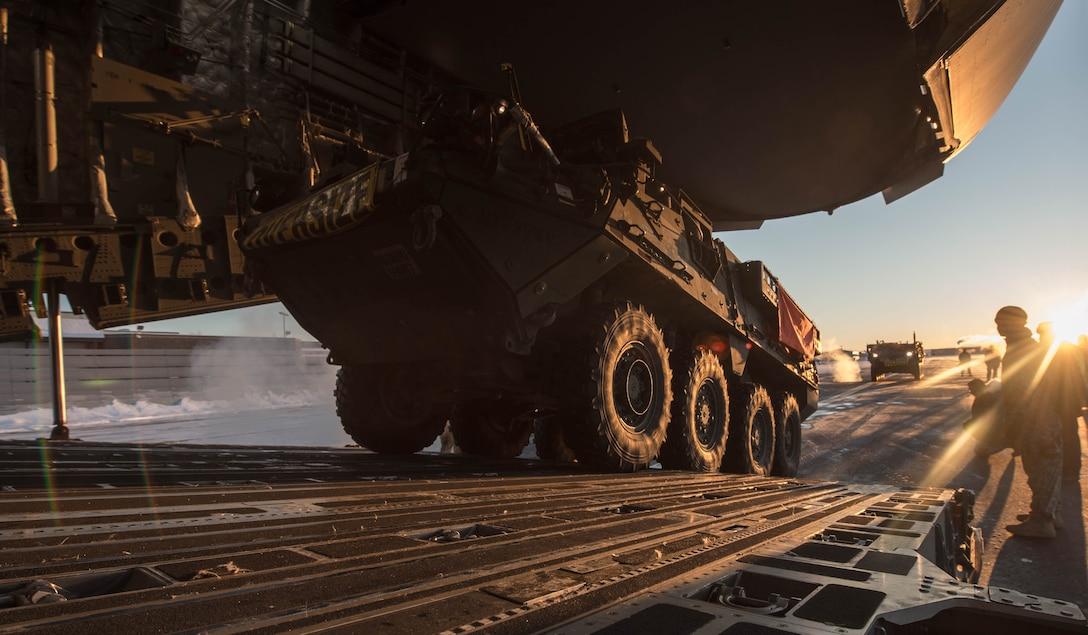 A Stryker armored vehicles from the 1st Battalion, 24th Infantry Regiment, 1st Stryker Brigade Combat Team, 25th Infantry Division, is loaded onto a C-17 Globemaster III aircraft, Dec. 13, 2016, at Eielson Air Force Base, Alaska. A contingency response team was sent to Eielson AFB to support the Army's Rapid Alaska Airlift Week exercise. (U.S. Air Force photo by Staff Sgt. Robert Hicks)