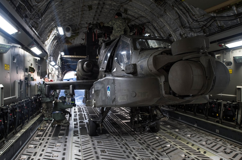 An AH-64 Apache helicopter from the 1st Attack Reconnaissance Battalion, 25th Combat Aviation Brigade, sits in a C-17 Globemaster III aircraft, Dec.14, 2016, at Eielson Air Force Base, Alaska. A contingency response team was sent to Eielson AFB to support the Army's Rapid Alaska Airlift Week exercise. (U.S. Air Force photo by Staff Sgt. Robert Hicks)
