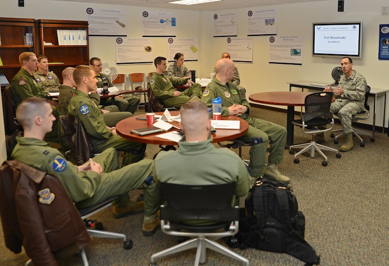 Col. Leonard Kosinski (right), 62nd Airlift Wing commander, talks to Team McChord flight commanders during a flight commanders course Dec. 16, 2016, at Joint Base Lewis-McChord, Wash. The quarterly course provides briefings from a variety of base agencies and has open discussions from squadron commanders and McChord leadership. (U.S. Air Force photo/Senior Airman Jacob Jimenez)